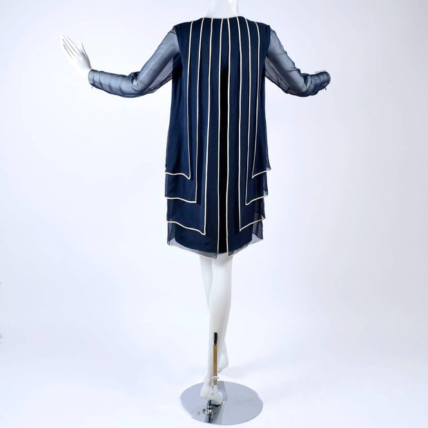 1970's vintage couture navy blue dress with layered pannels lined in white