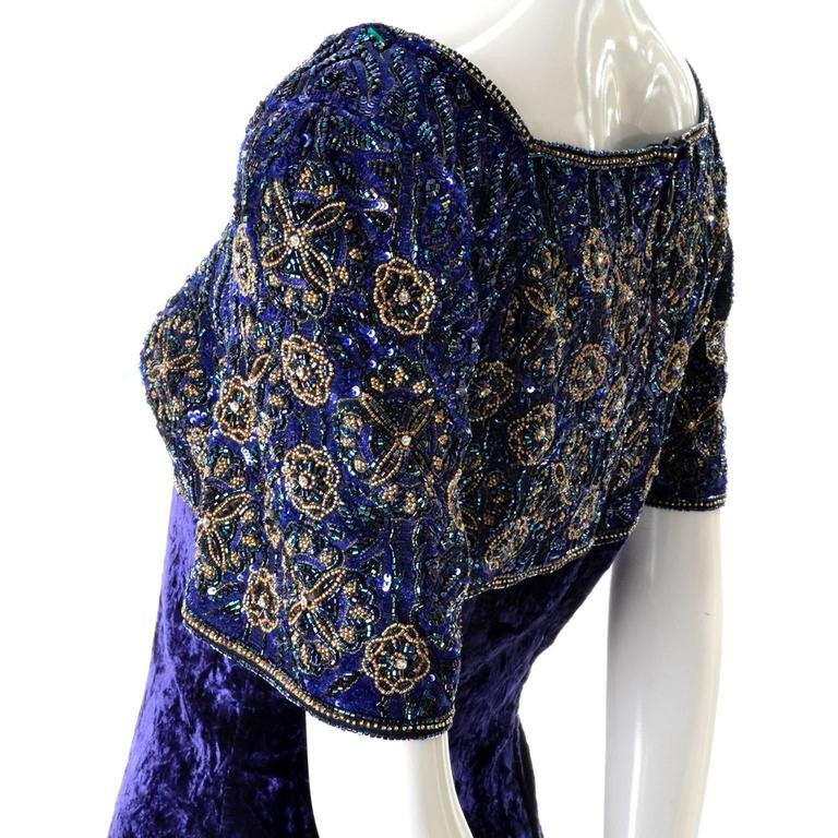 Blue beading and gold sequined bodice of this purple velvet vintage 1990's maxi dress