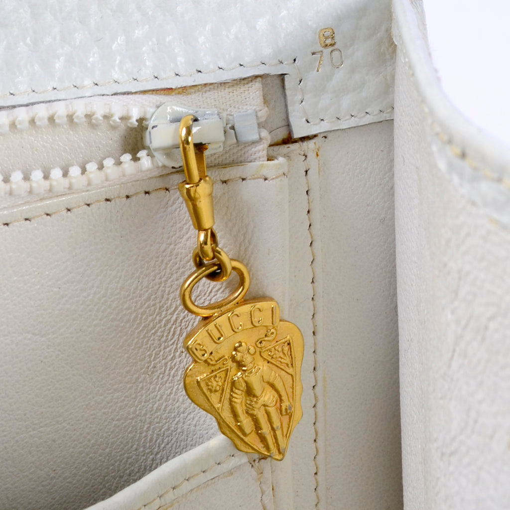Gucci gold medallion zipper pull