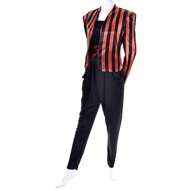 Strapless black 1970's jumpsuit with Halloween orange and black striped satin jacket and matching cummerbund