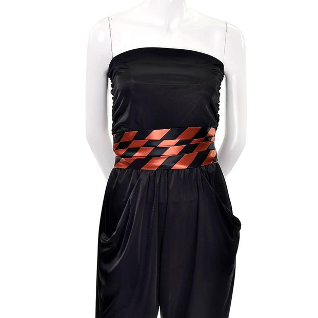 Strapless draping vintage black jumpsuit with black and orange striped cummerbund and satin jacket