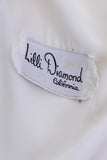 Lilli Diamond label from a 1970's white vintage maxi dress
