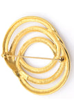 Monet gold vintage circle pin brooch