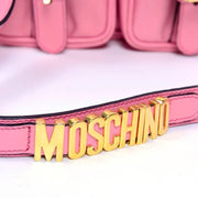 MOSCHINO gold letters on strap of handbag