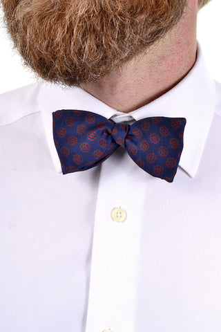 Vintage bow tie with navy blue ground and burgundy red flower shapes