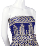 Blue silk strapless evening gown with silver design