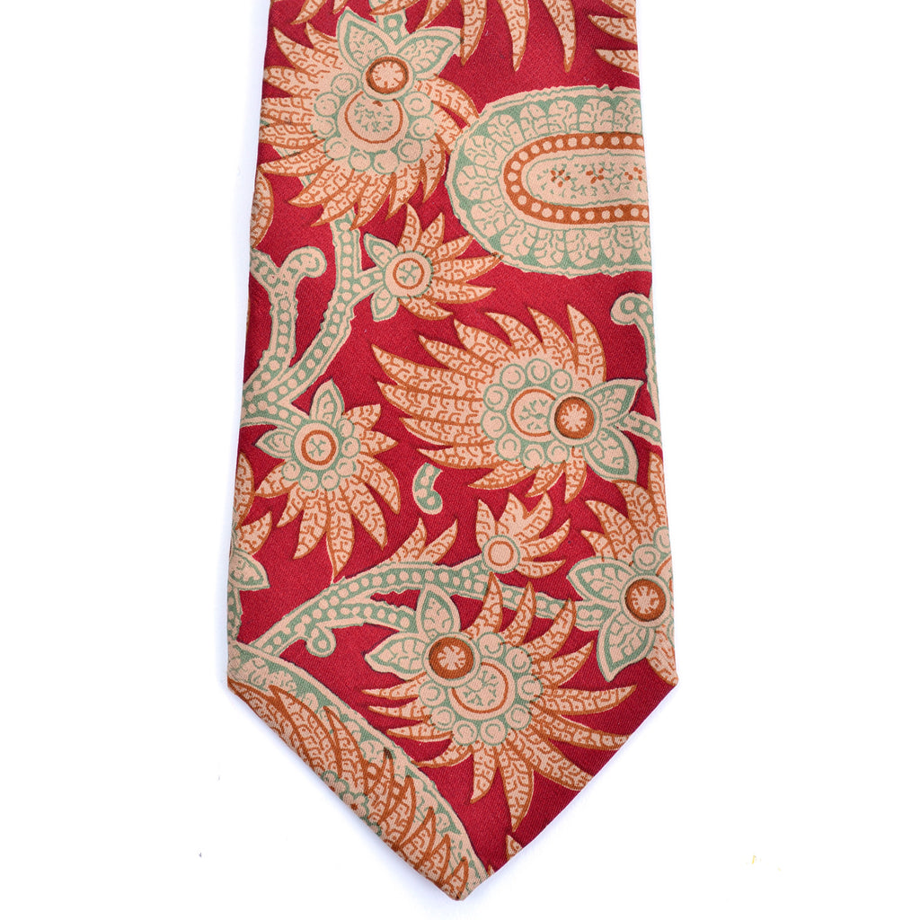 Abstract floral and paisley print on this burgundy silk Pierre Balmain vintage necktie