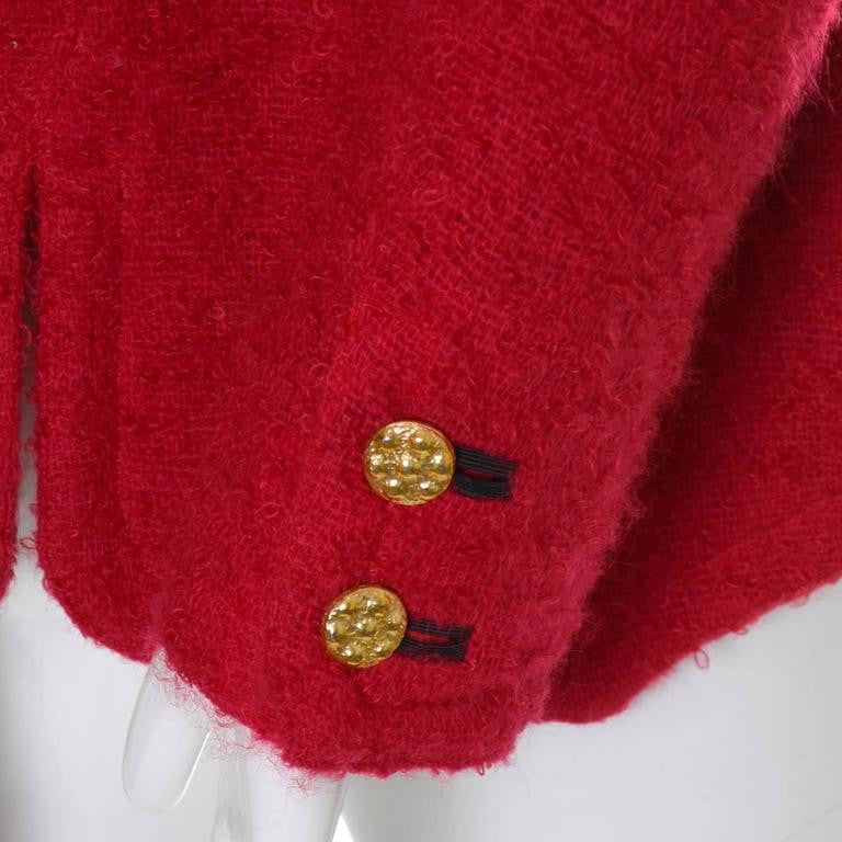 Gold button details on a red boucle vintage blazer YSL 1990s or 1980s