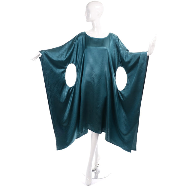 Teal Caftan with avant garde circle cutouts in sides
