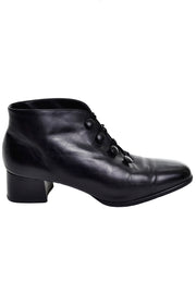 Short black leather boots with heel
