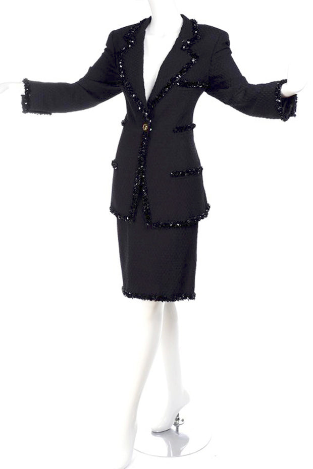 1990's Ungaro black skirt suit with beaded trim and long blazer