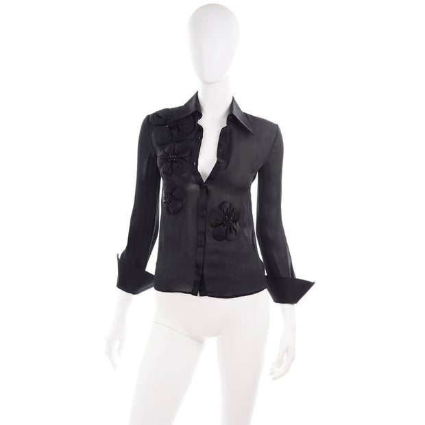 Black sheer fitted blouse by Valentino with floral appliques