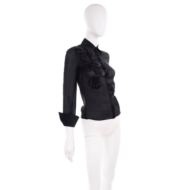 Sheer black floral applique blouse by Valentino