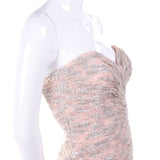 Ruched pink and silver strapless formal gown with slit