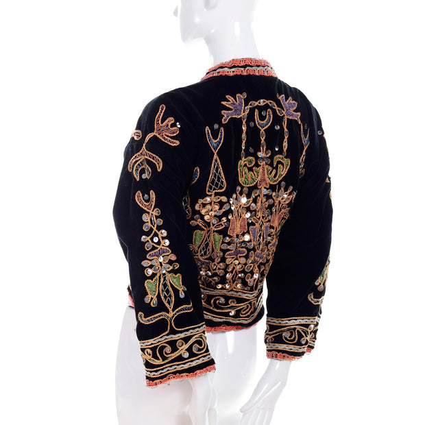 Ornately designed black velvet open front jacket