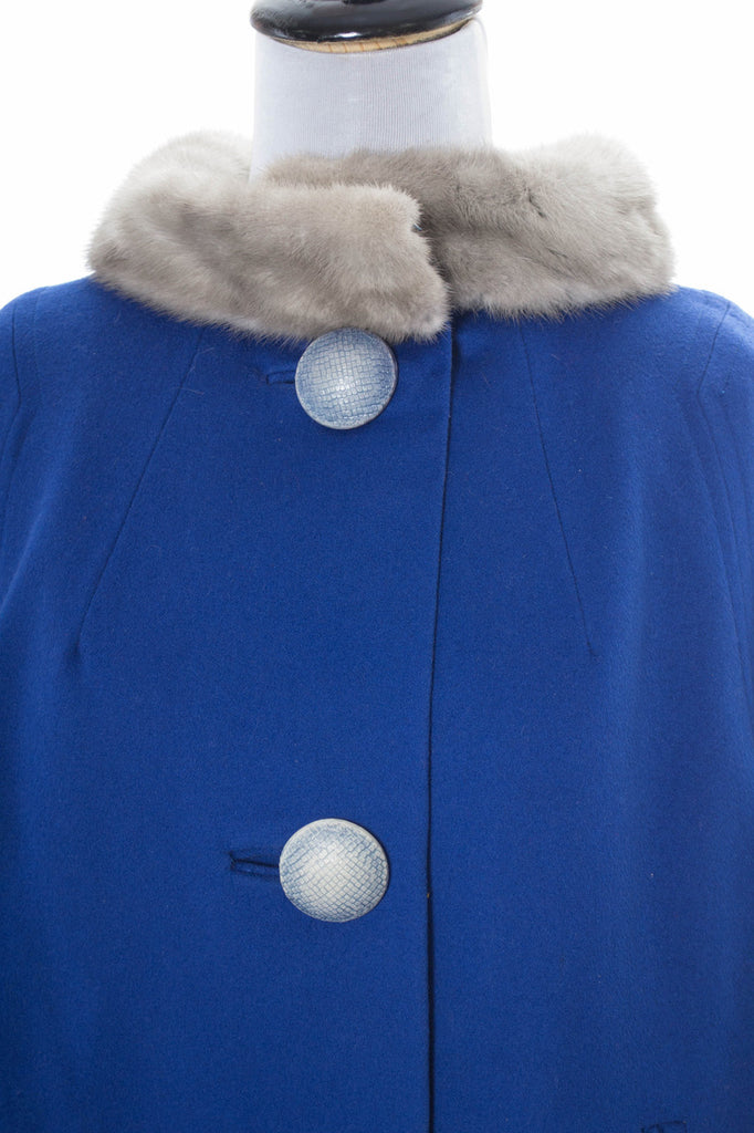 Blue vintage coat with fur collar and giant buttons