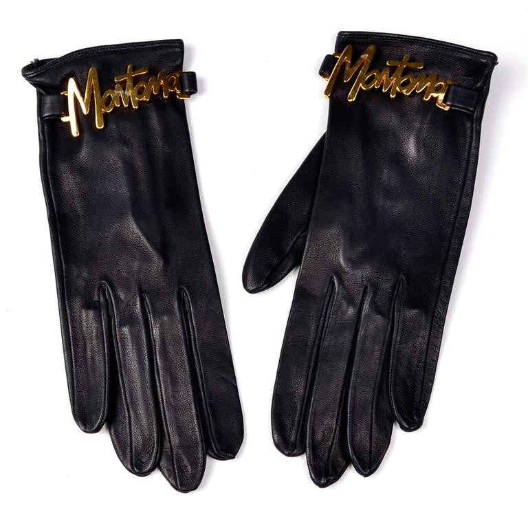 Black leather Claude Montana vintage gloves with gold tone lettering