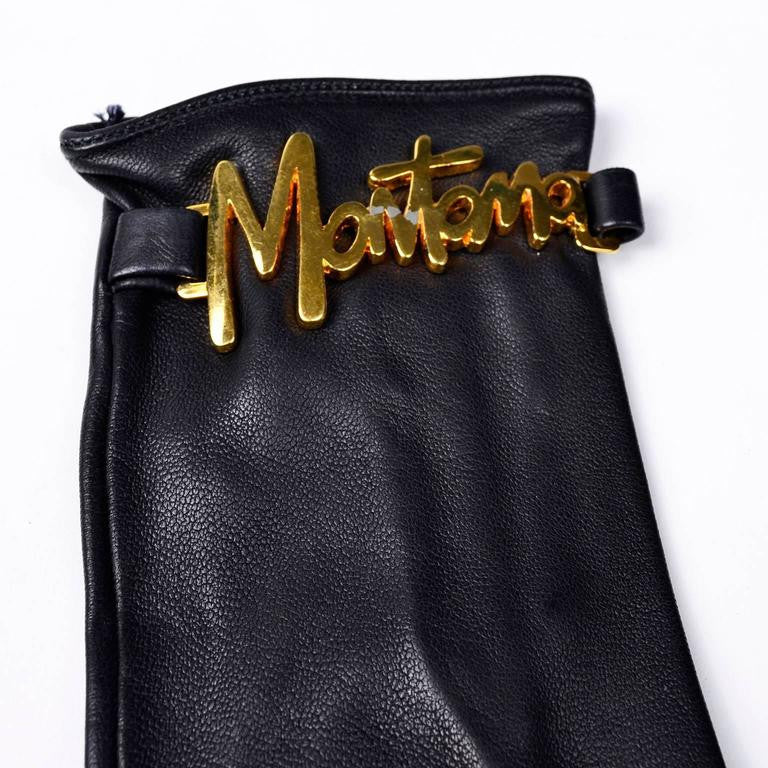 """Montana"" gold tone on the wrists of vintage black leather gloves by designer Claude Montana in the 1980's"