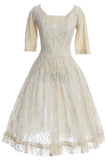 Cream lace 1950s wedding dress