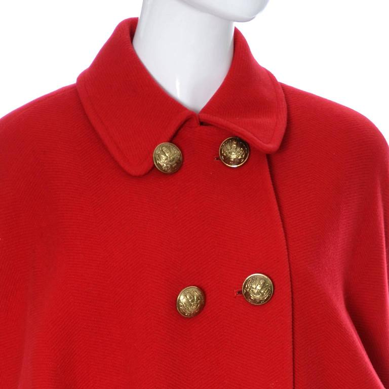 Large brass buttons on red wool vintage coat