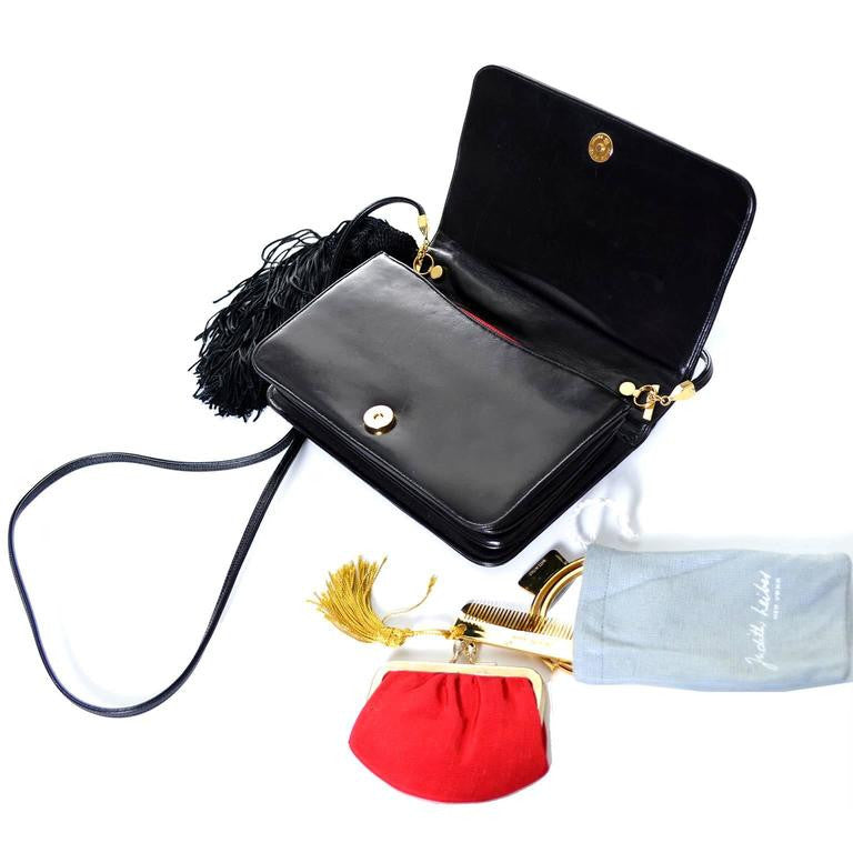 Judith Leiber patent leather bag with tassel and animals. Comes with mirror, comb and coinpurse