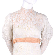 Illusion lace wedding gown with peach sash