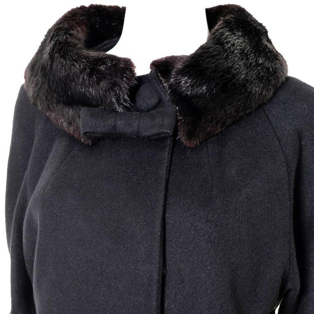 Black wool Lilli Ann vintage swing coat from the 1960's with fur cuffs and collar