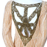 Gold macrame on the back of a 1980's pleated silk Mary McFadden Evening Gown vintage dress