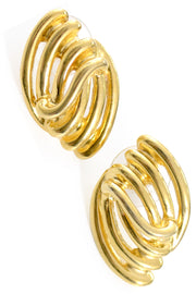 Vintage Monet gold tone pierced earrings open swirl - Dressing Vintage