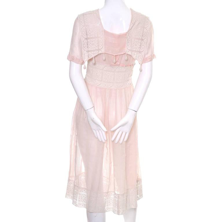 Pink cotton vintage dress with tone on tone stripes and crochet details