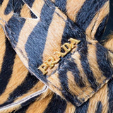 Prada zebra print pony fur loafers 7.5 with gold logo