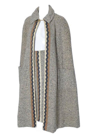 Vera Maxwell winter cape and matching tweed skirt with a zig zag trim