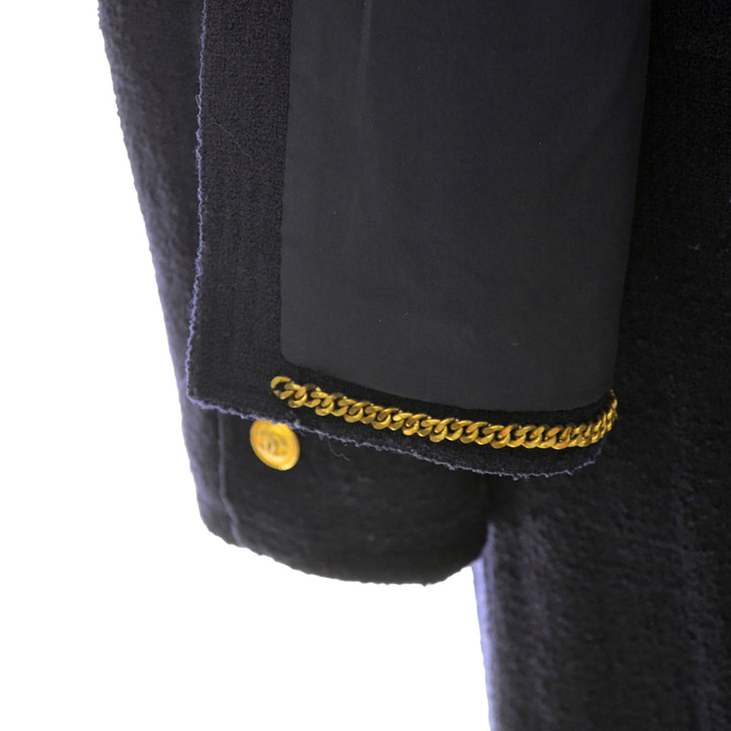 1970s or 1980s Navy Blue Wool Vintage Chanel Boutique Skirt Suit with Chain in the Hem of Jacket