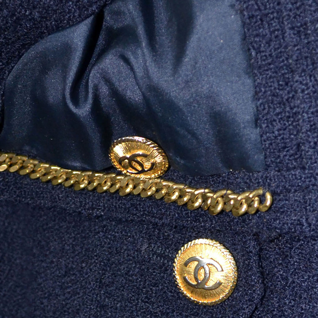 1970s or 1980s Navy Blue Wool Vintage Chanel Boutique Skirt Suit with Chain and Logo Buttons