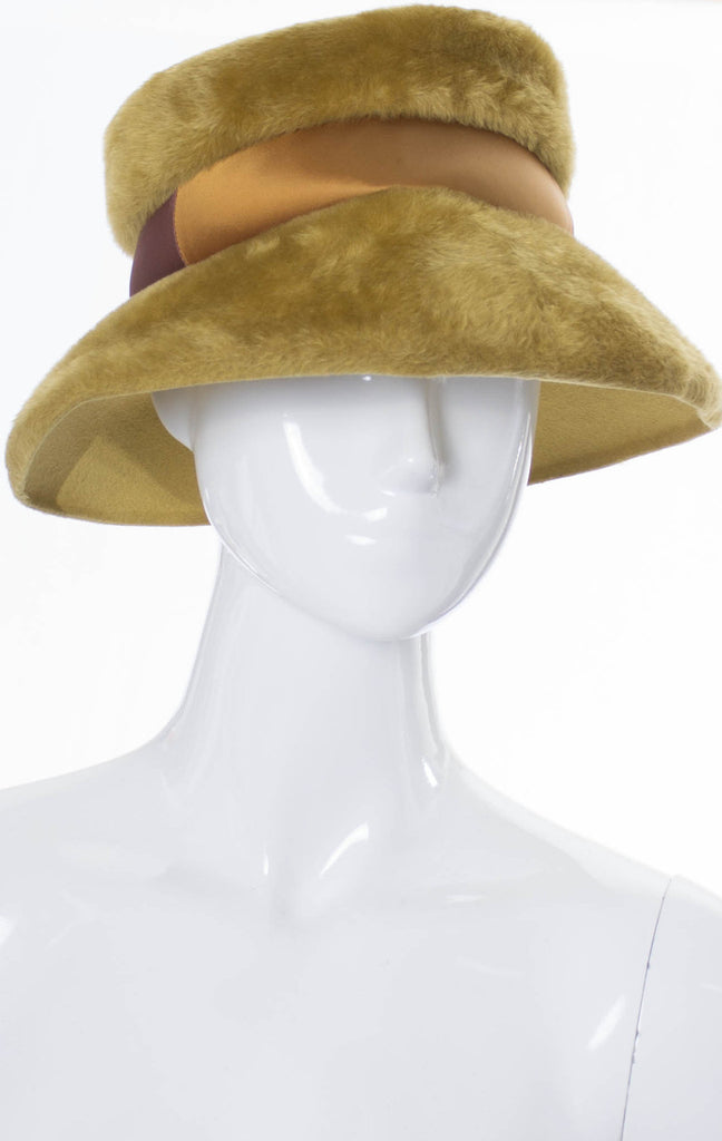 Wonderful 1960s vintage faux fur hat with two-toned ribbon