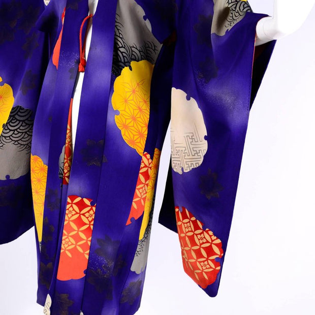Detail of graphic style purple orange yellow Kimono silk