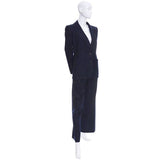 Vintage dark blue pinstripe pantsuit by Yves Saint Laurent. Pant and blazer suit with high waist pants and shoulder pad blazer