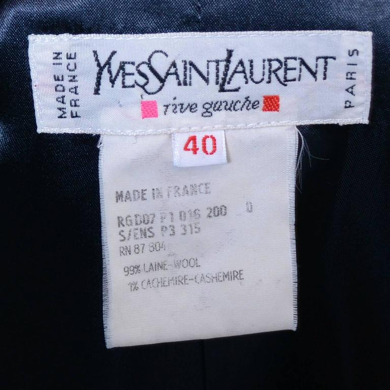 Yves Saint Laurent Rive Gauche label from the 1980's or early 1990's inside a pinstripe navy blue pantsuit