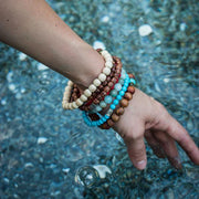 Girl Wearing Masako PolyChromatic MultiColor Blue Amazonite Bead Stackable Bracelet