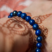 Girl Wearing Nelu Dark Blue 8mm Lapis Lazuli Bead Stretch Bohemian Stackable Bracelet