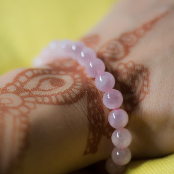 Girl Wearing Primrose Light Baby Pink Rose Quartz 8mm Bead Boho Stackable Bracelet