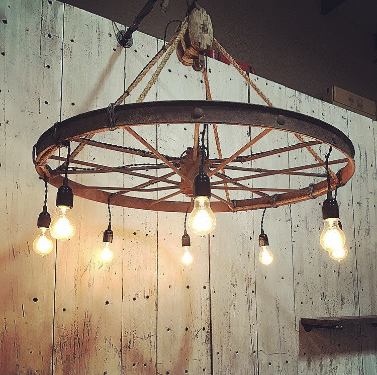 Wagon wheel chandelier boxcar house llc wagon wheel chandelier mozeypictures Image collections