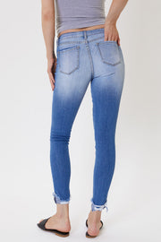 The Mid-Rise Destroyed Light Wash Ankle Skinny Jeans