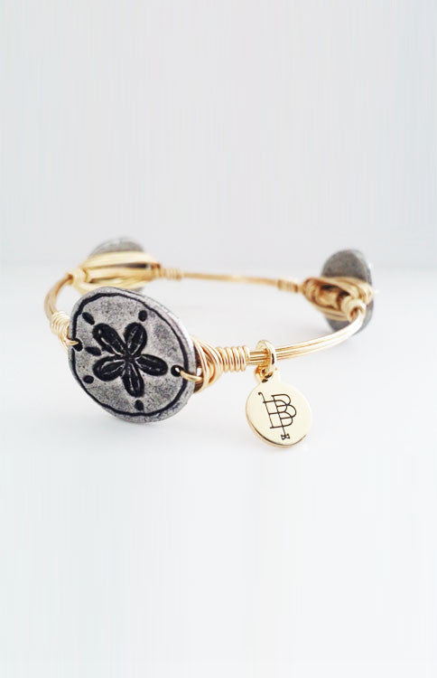 Bourbon and Boweties - Silver Sand Dollar Bangle Jewelry Bourbon and Boweties - Bows and Arrows FSU Seminoles and UF Gators Women's Game Day Dresses and Apparel