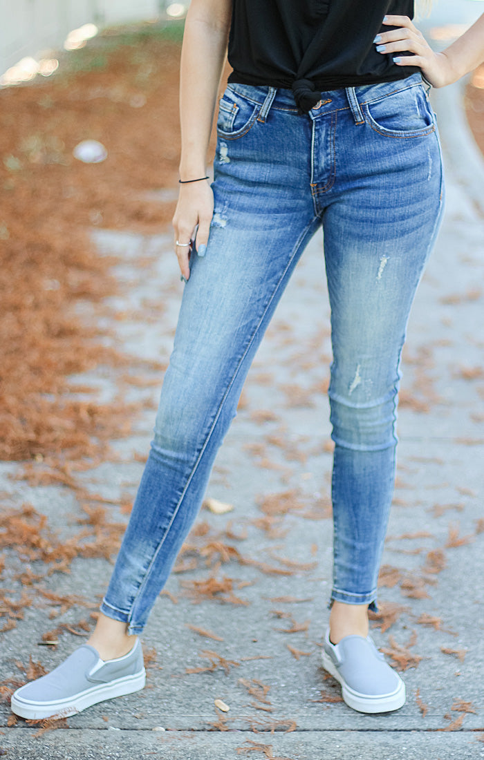 The Distressed Mid-Rise Skinny Jean with Step Hem (Medium Wash)