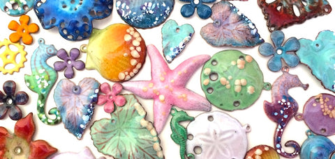 variety of torch fired enamel charms