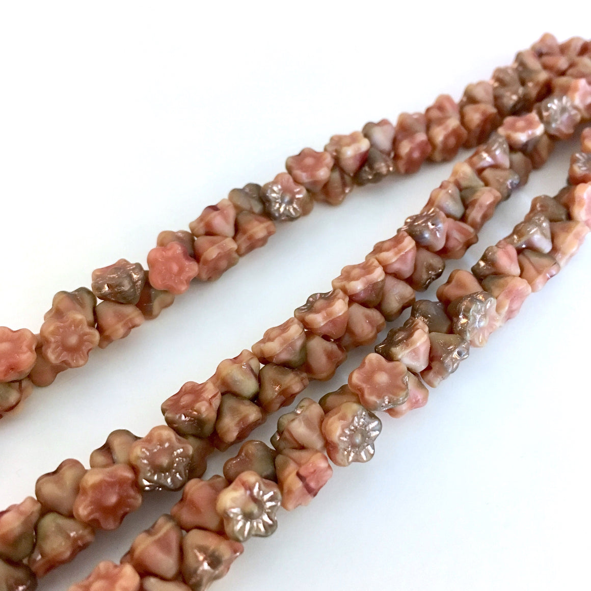 Apollo Caramel Pink button style flower beads