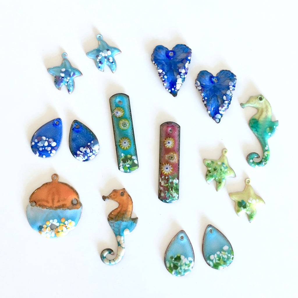 torch fired enamel charms by Colleen Ewart