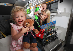 Amelia Harrison - Herald Sun feature with Toby the Teddy