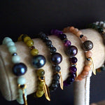 GEMSTONE AND NATURAL PEARL BRACELETS